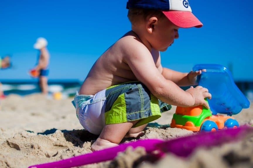 toddler playing beach